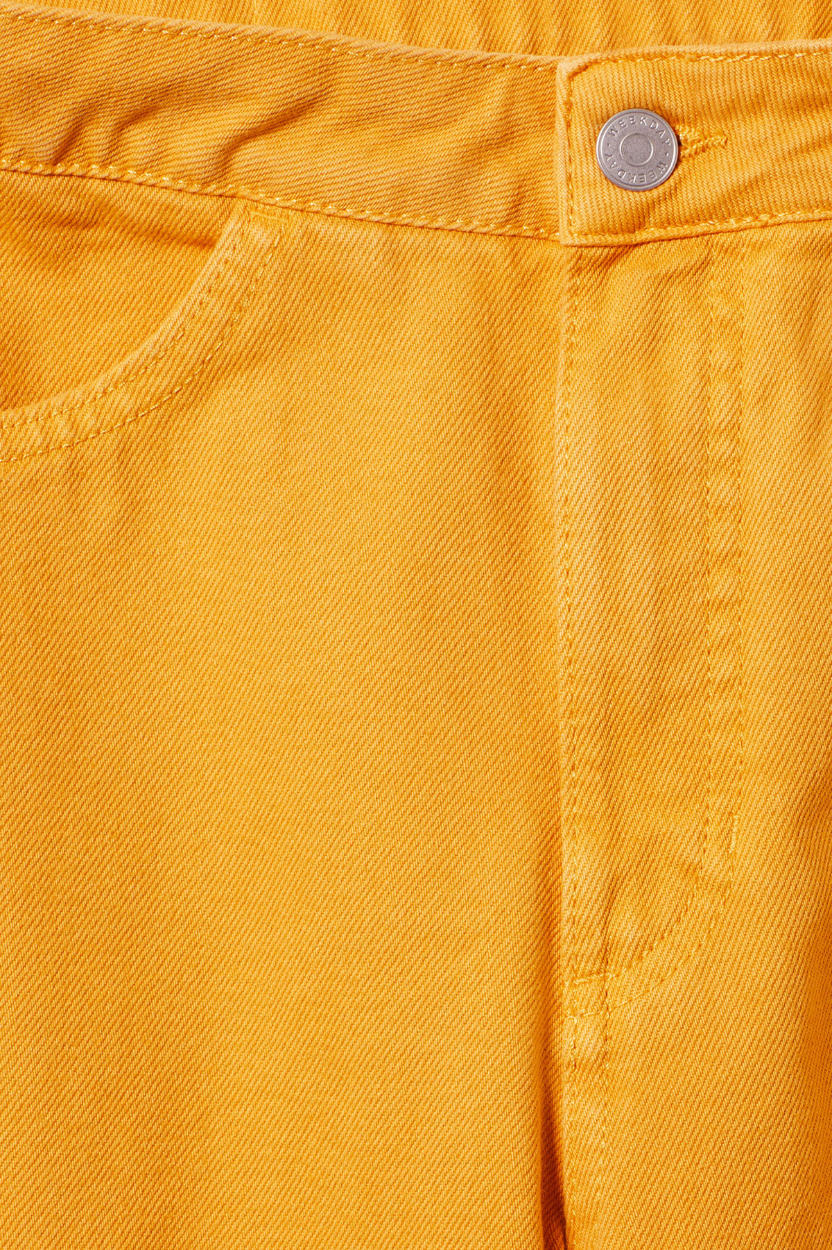 Detailed image of Weekday vida yellow denim trousers in yellow