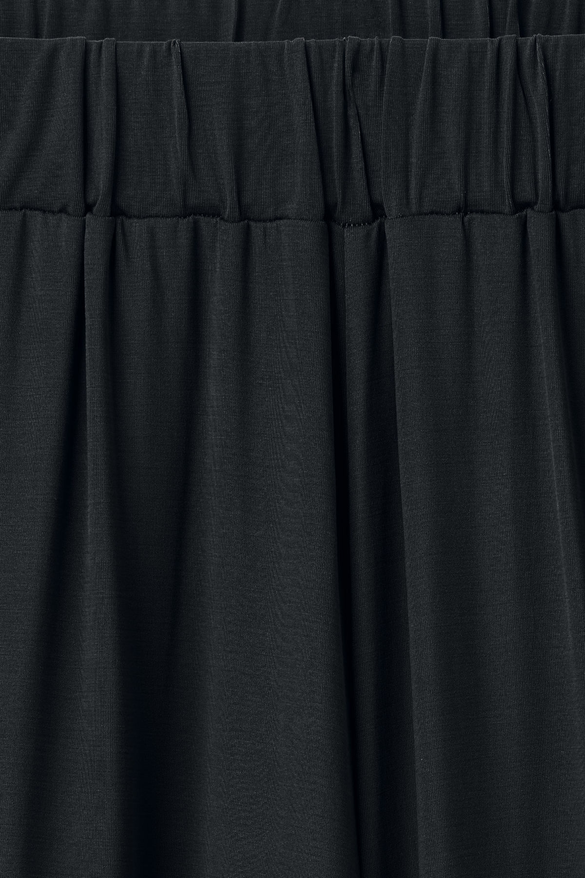 Detailed image of Weekday essen cupro trousers  in black