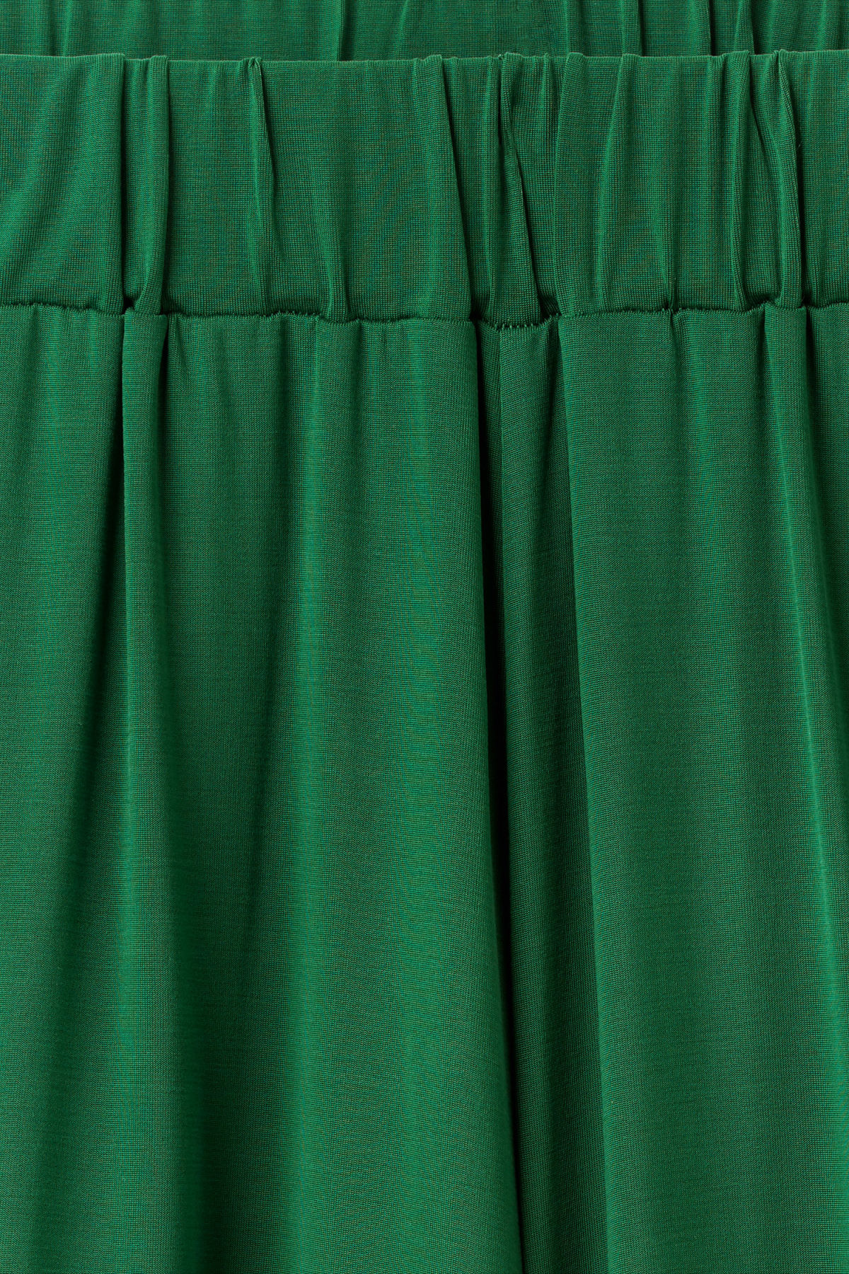 Detailed image of Weekday essen cupro trousers  in green