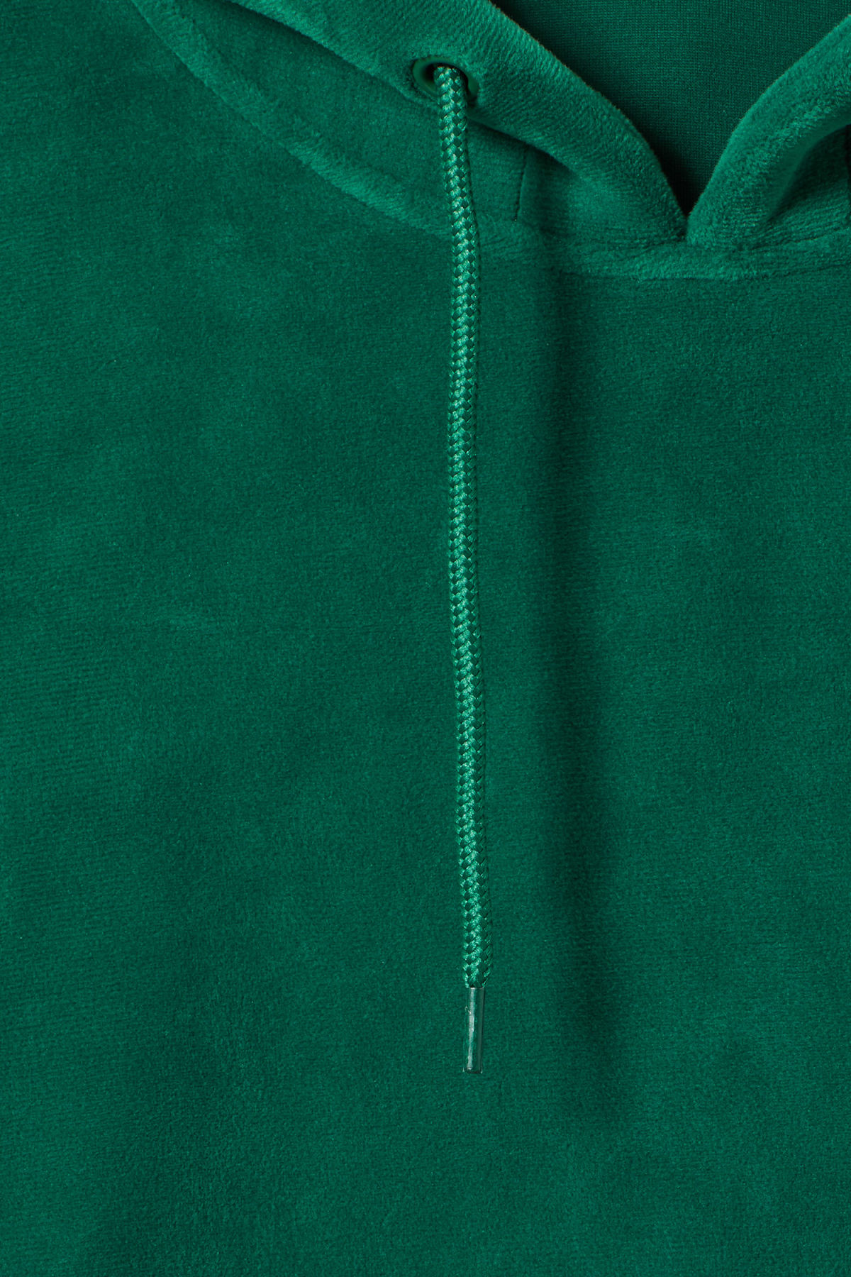 Detailed image of Weekday big hawk velvet hoodie in green