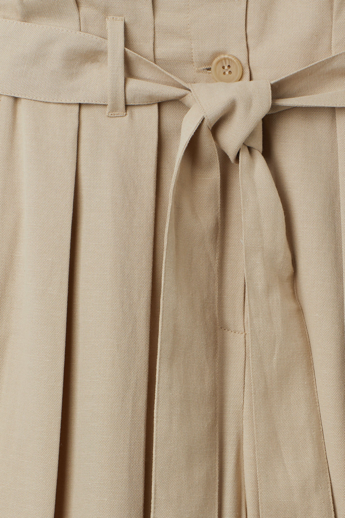 Detailed image of Weekday mucha trousers in beige
