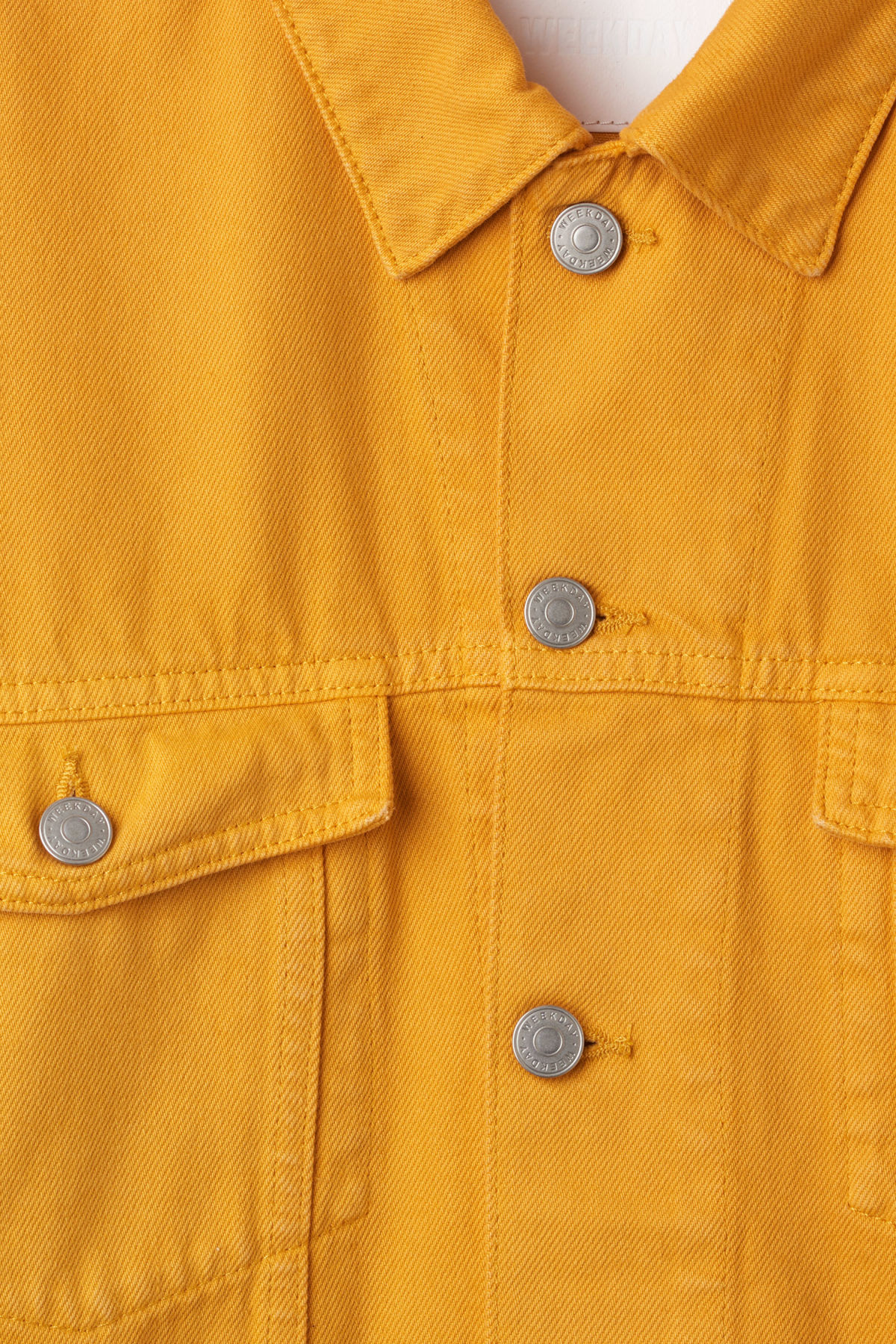 Detailed image of Weekday dune yellow jacket  in yellow