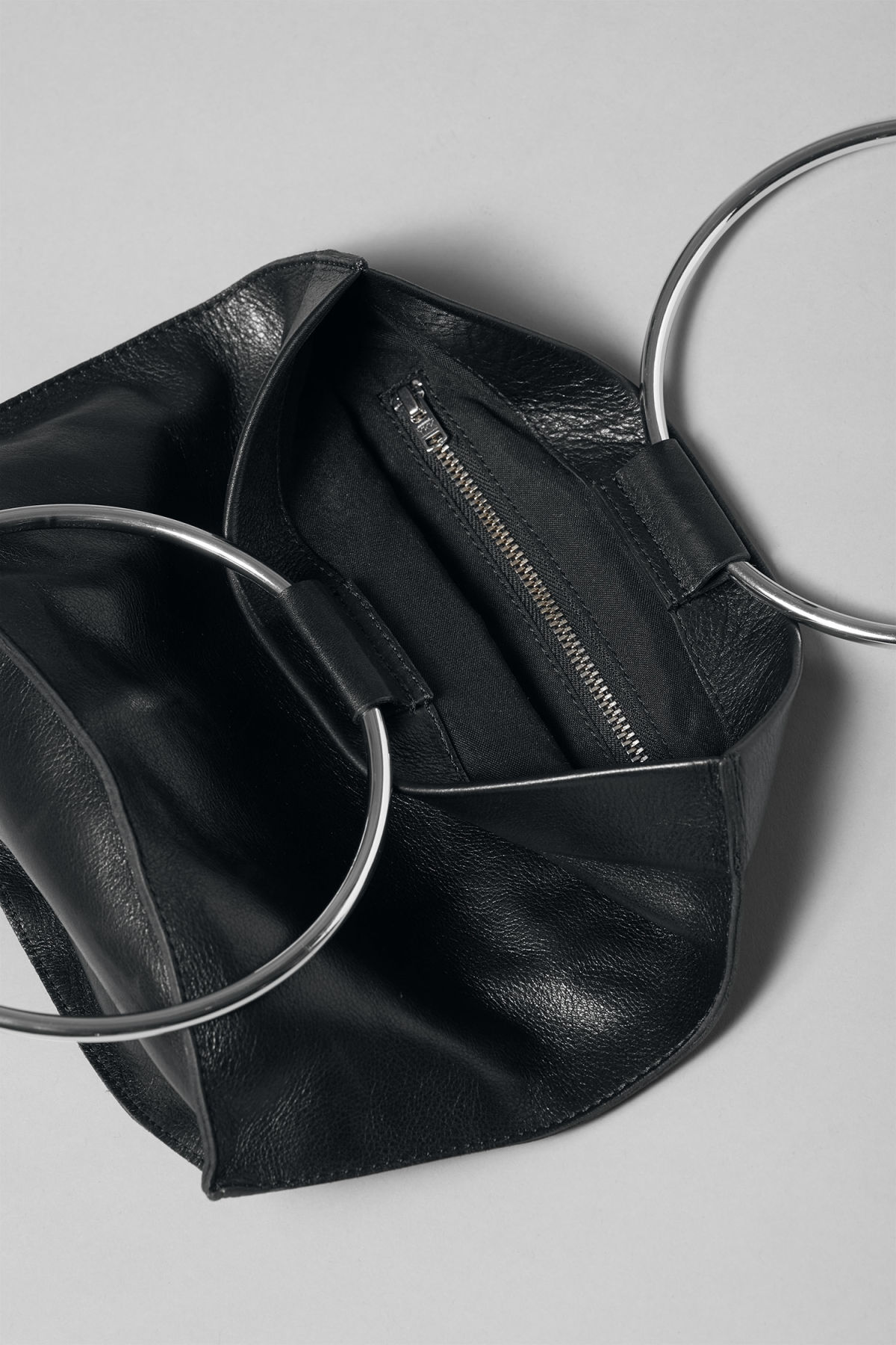Detailed image of Weekday ring leather bag in black