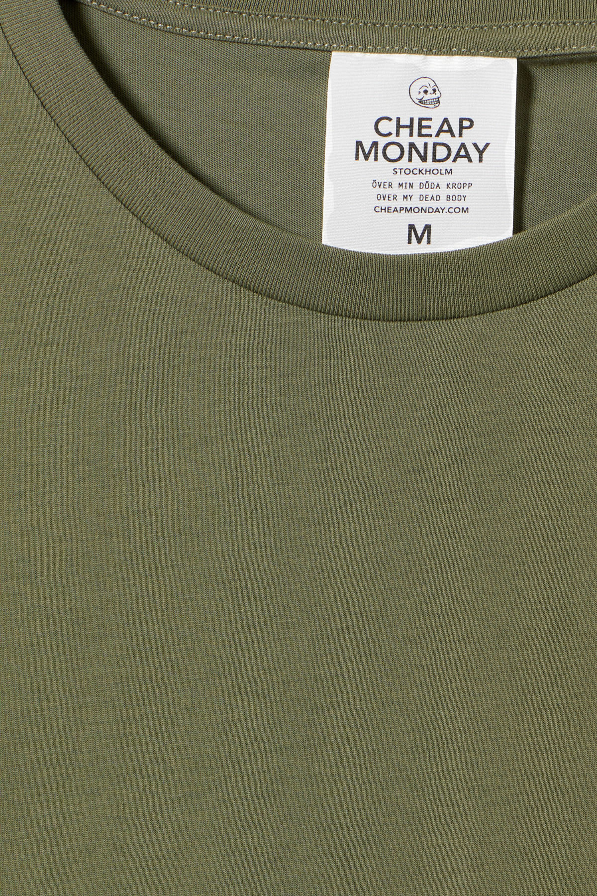 Detailed image of Weekday standard tiny skull t-shirt  in green