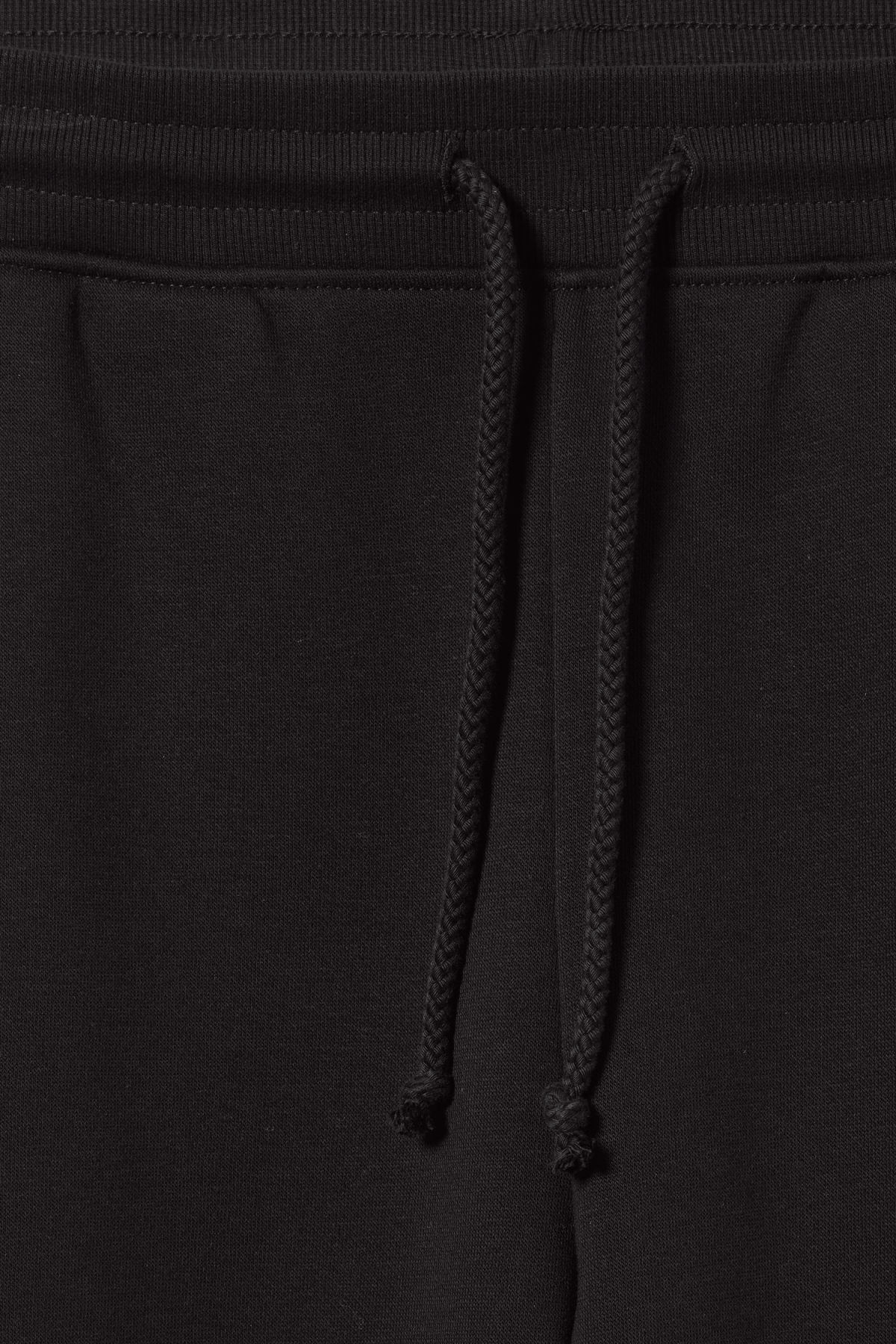 Detailed image of Weekday alena sweatpants in black