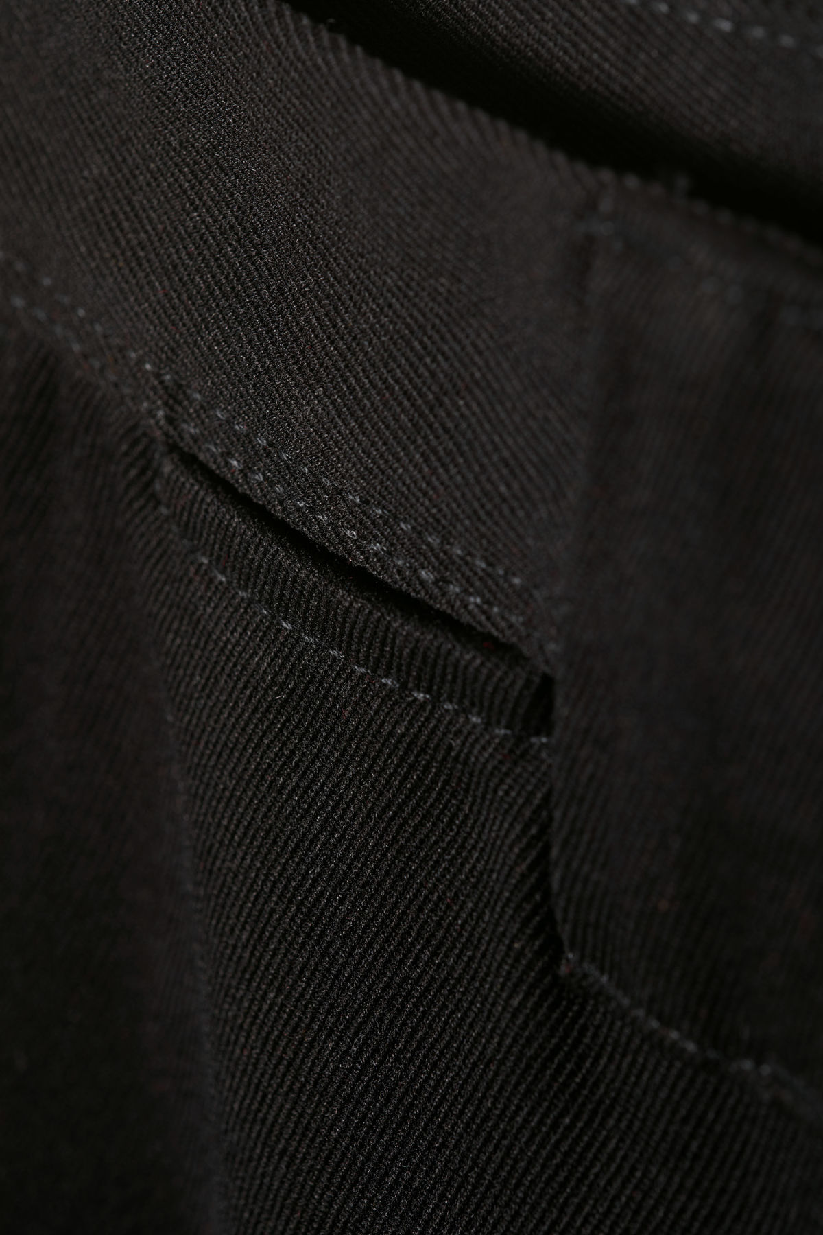 Detailed image of Weekday tilo trousers in black